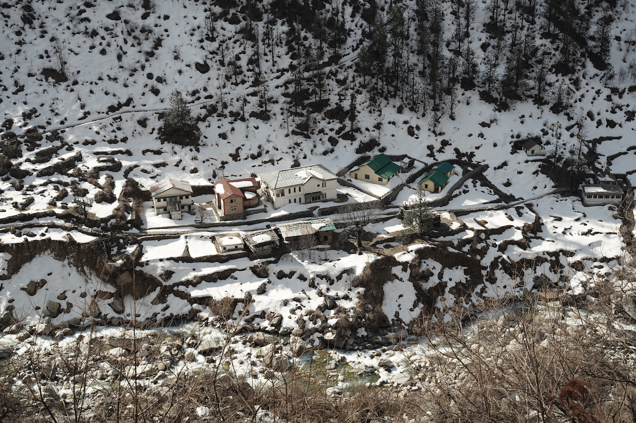 Sunlight shines on colourfull roof in snow covered houses of osla village