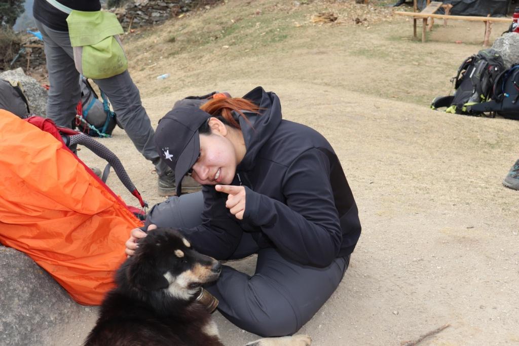 trekker with dog posing for camera