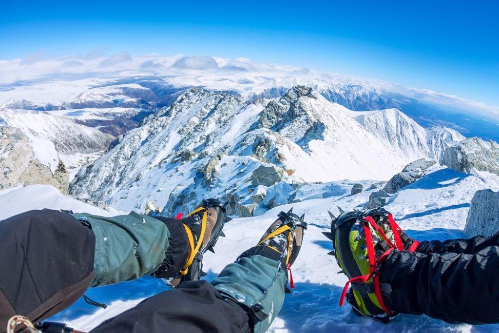 trekkers wearing crampons for climb