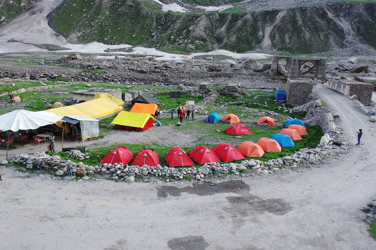 Tent placed at the ground beside road at a campsite at Chhatru
