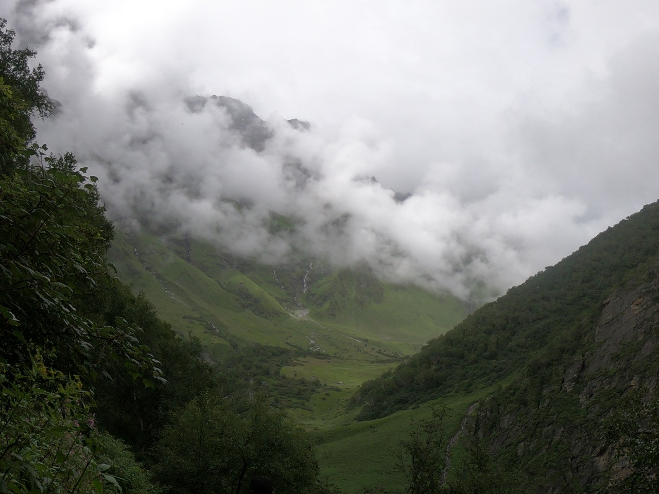 Cloud floating below green mountain enroute to Valley of flower